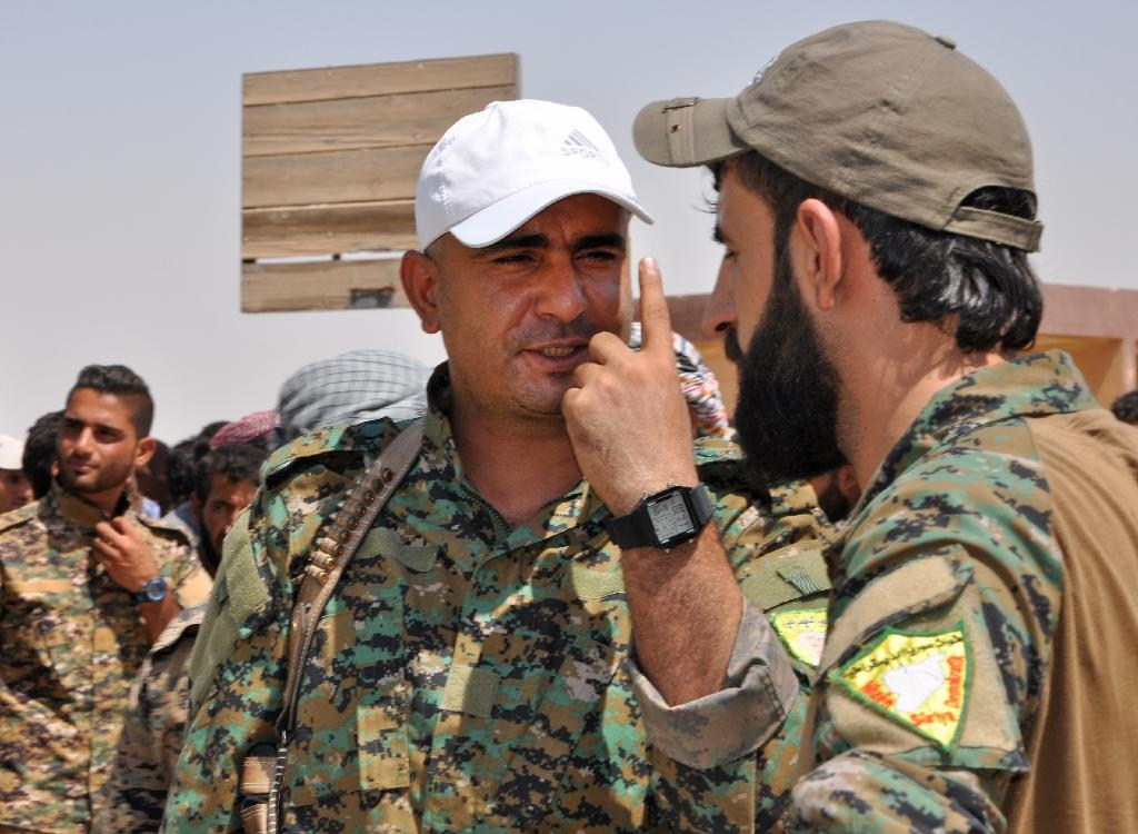 Ahmad Abu Khawlah (C), chief of the Deir Ezzor Military Council at a DEMC press conference in the town of Shadadi on August 25, 2017 (AFP Photo/Ayham al-Mohammad)