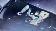 Wallet or phone? Driver's controversial photo sparks debate