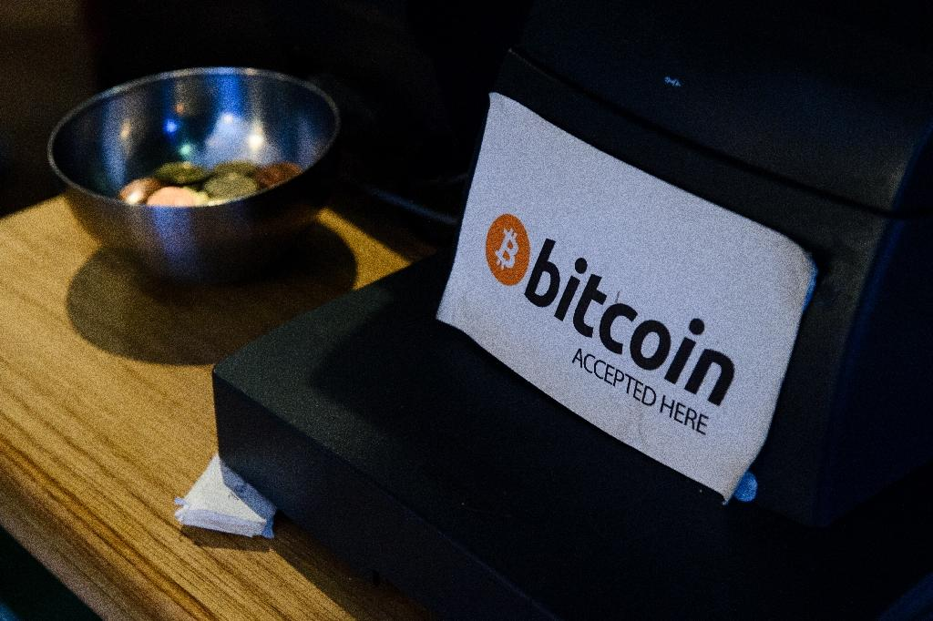 Bitcoins are accepted by many online as well as bricks and mortar retailers, like at this shop in Dublin (AFP Photo/LEON NEAL)