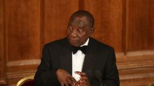 South Africa's Ramaphosa cuts short Britain trip to deal with protests at home