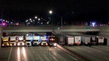 13 heroic truck drivers line up under highway bridge to prevent suicide attempt