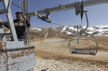 Worker is seen at a closed ski resort due to the lack of snow in north of Beirut