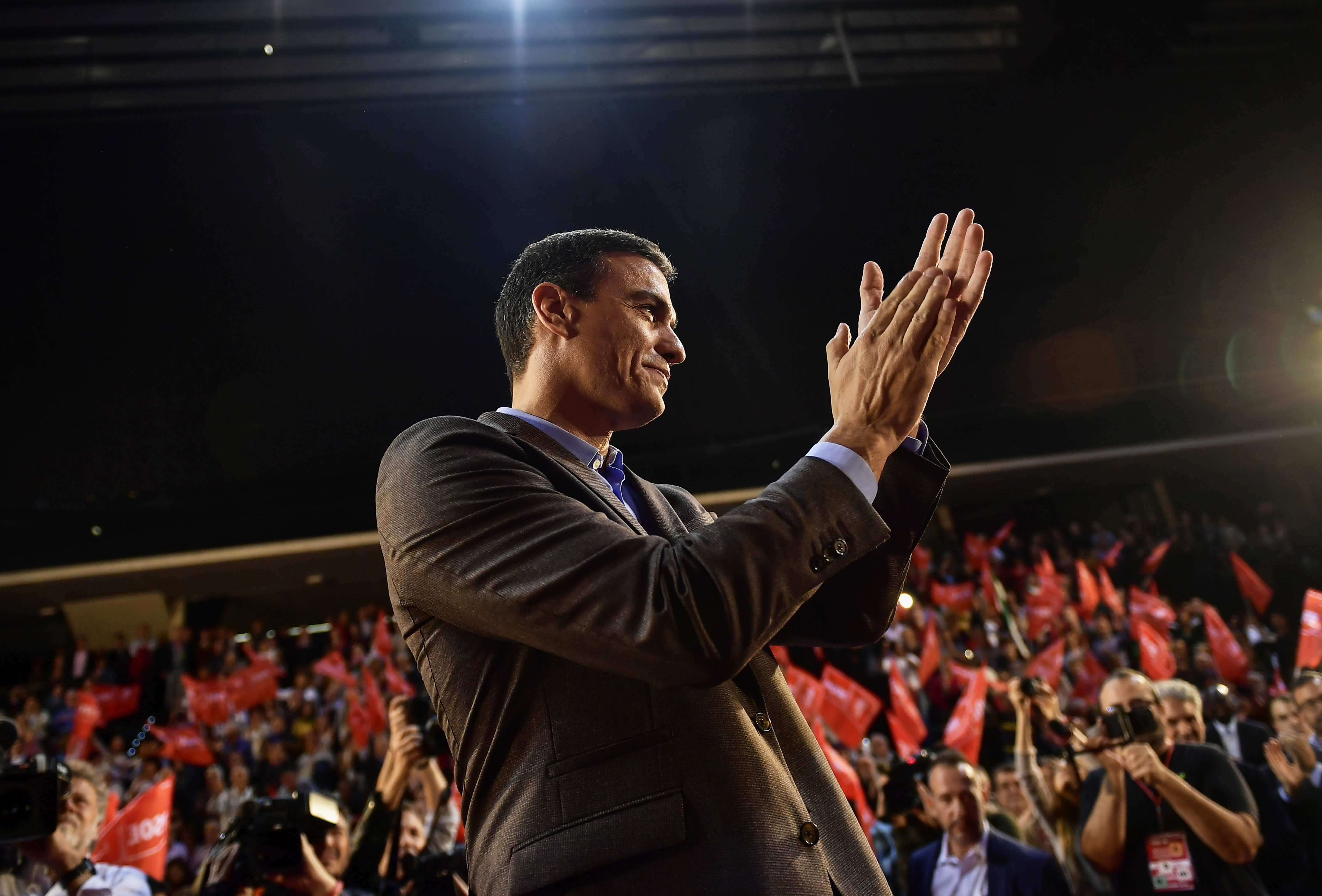 FILE - In this Nov. 1, 2019, file photo, Spain's caretaker Prime Minister and socialist candidate Pedro Sanchez applauds socialist followers during a general election campaign rally in Pamplona, northern Spain. Sanchez's Socialists won Spain's national election on Sunday but large gains by the upstart far-right Vox party appear certain to widen the political deadlock in the European Union's fifth-largest economy. (AP Photo/Alvaro Barrientos, File)