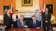 May strikes £1 billion deal with DUP to prop up government