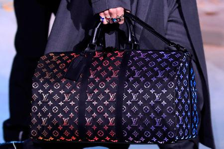 85acbf86c2f67d A model presents a bag creation by designer Virgil Abloh as part of his  Fall/