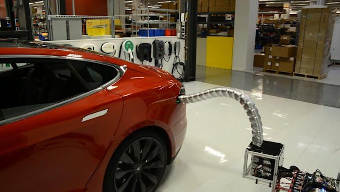 Tesla's prehensile car charger plugs itself in automatically