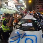 'Undercover Hong Kong police car' discovered by protesters and gets vandalised
