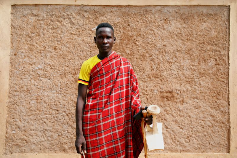 Lopeyok Ekidor, 26, from the Turkana tribe poses for a picture in the village of Lorengippi near the town of Lodwar, Turkana county