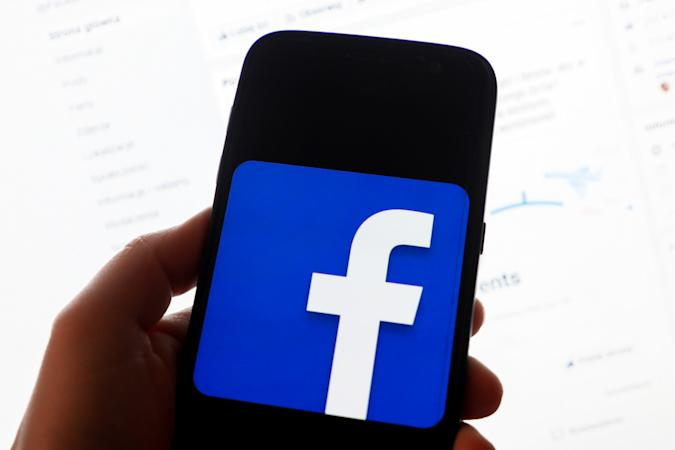 Facebook logo is displayed on a mobile phone screen photographed for illustration photo in Krakow, Poland on 29 January, 2019.  (Photo by Beata Zawrzel/NurPhoto via Getty Images)