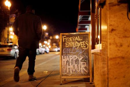 FILE PHOTO: A sign is displayed at a local bar during the partial U.S. government shutdown in Washington