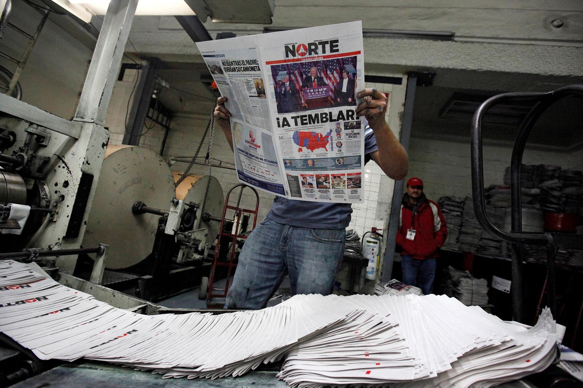 "<p>A worker reads a freshly printed newspaper with the headline reading ""We will tremble"" at a printer of the local daily Norte in Ciudad Juarez, Mexico on Nov. 9, 2016. (Photo: Jose Luis Gonzalez/Reuters) </p>"