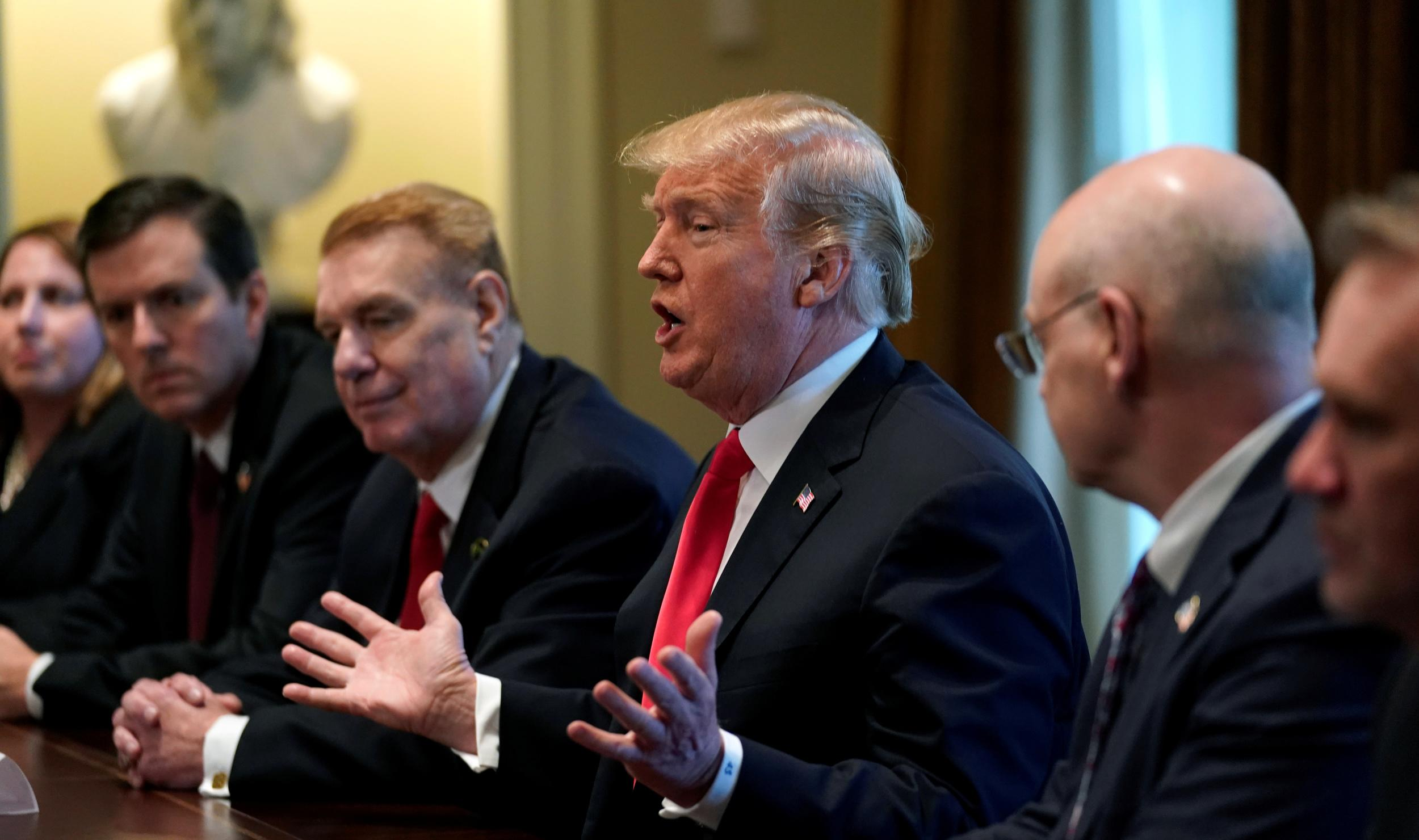 U.S. President Donald Trump announces that the United States will impose tariffs of 25 percent on steel imports and 10 percent on imported aluminum during a meeting at the White House in Washington, U.S., March 1, 2018. REUTERS/Kevin Lamarque