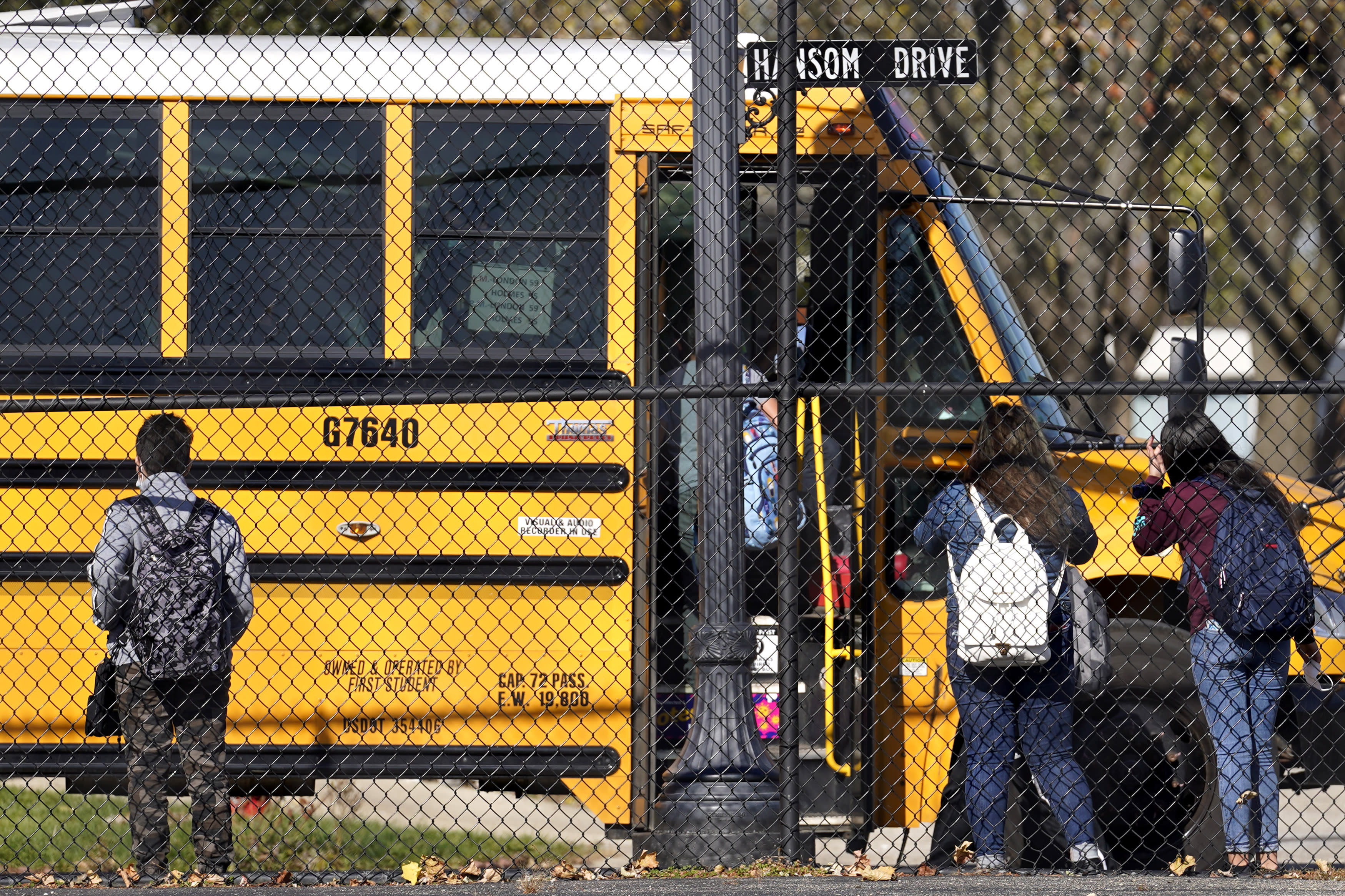 With COVID-19 surging, schools suspend in-person education