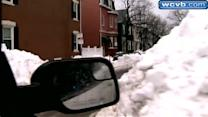 Snow covered Boston neigborhood using lawn chairs for parking