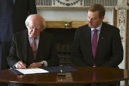President Michael D. Higgins signs Prime Minister Enda Kenny's (R) Seal of Government to office of Taoiseach in Dublin, Ireland May 6, 2016. REUTERS/Clodagh Kilcoyne
