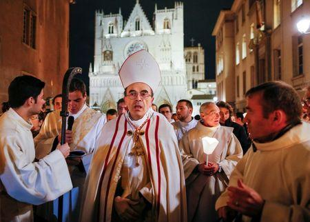 French Archbishop Philippe Barbarin leads the traditional procession to Mary, in Lyon