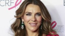 Elizabeth Hurley rocks plunging yellow bikini top and heart-shaped sunglasses at 54: 'Never aging I guess'