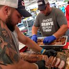 BBQers Set Friendly Rivalries Aside to Serve Meals, Hope to Hurricane Michael Victims