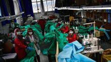 Job cuts pile up, Ford to make ventilators at parts plant