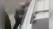 Bizarre moment a man headbutts a car