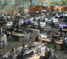 Stocks slip, but all eyes are on the bond market