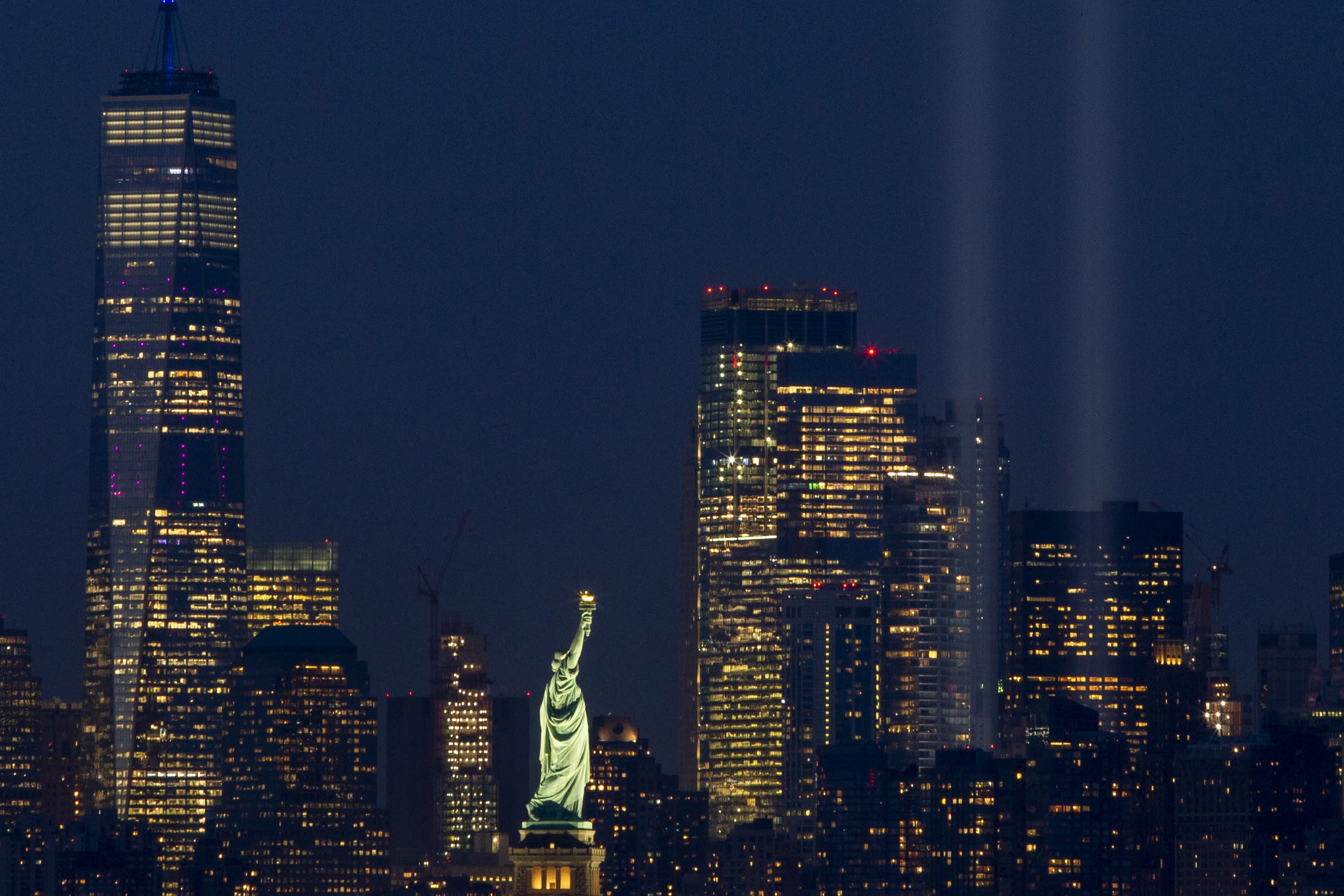 The Tribute in Light rises above the lower Manhattan skyline, Wednesday, Sept. 11, 2019 in Bayonne, N.J. (AP Photo/Eduardo Munoz Alvarez)