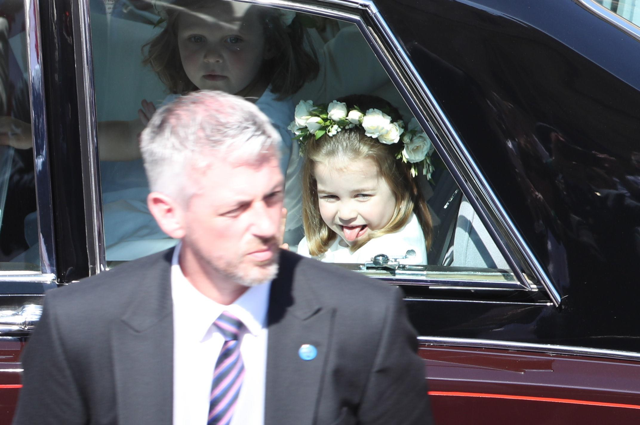 <p>Princess Charlotte sticks out her tongue as she rides in a car to the wedding of Prince Harry and Meghan Markle at St George's Chapel in Windsor Castle on May 19, 2018 in Windsor, England.</p>  <p>(Photo by Andrew Milligan - WPA/Getty Images)</p>