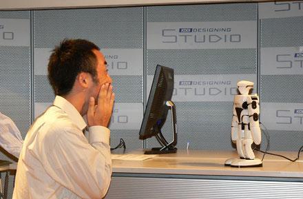 Speecys shows of SPC-101C face-recognizing robot