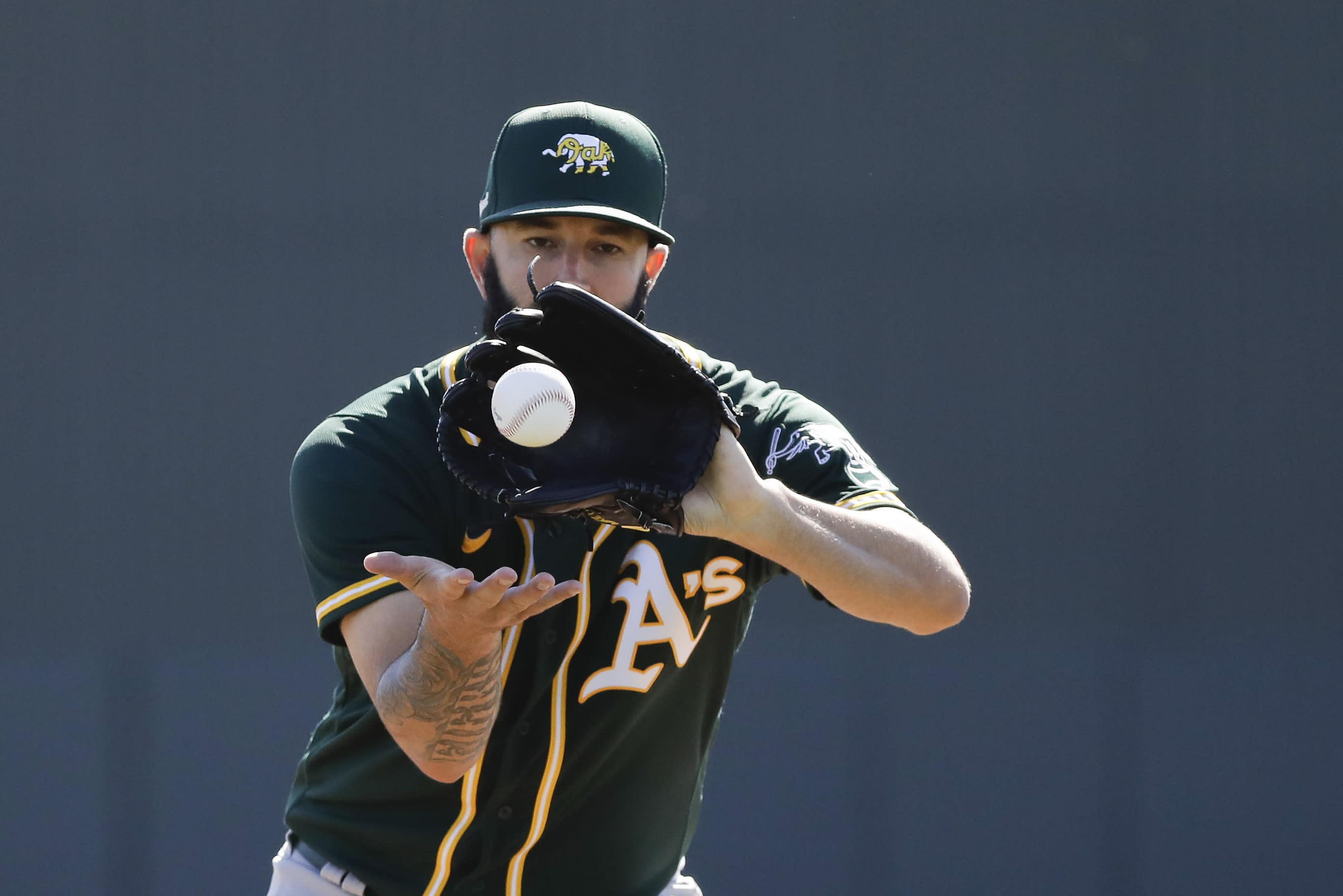 Oakland Athletics' Mike Fiers runs a drill during spring training baseball practice, Thursday, Feb. 13, 2020, in Mesa, Ariz. (AP Photo/Darron Cummings)