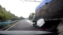 Speeding lorry rips off car's doors