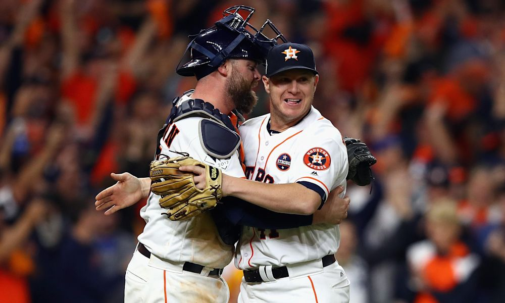 Brad Peacock (right) and Brian McCann celebrate victory in Game 3 of the World Series. (AP)