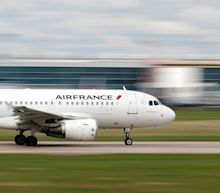 An Air France flight was forced to turn back in midair when staff found an unattended cellphone that wasn't claimed by any of the passengers