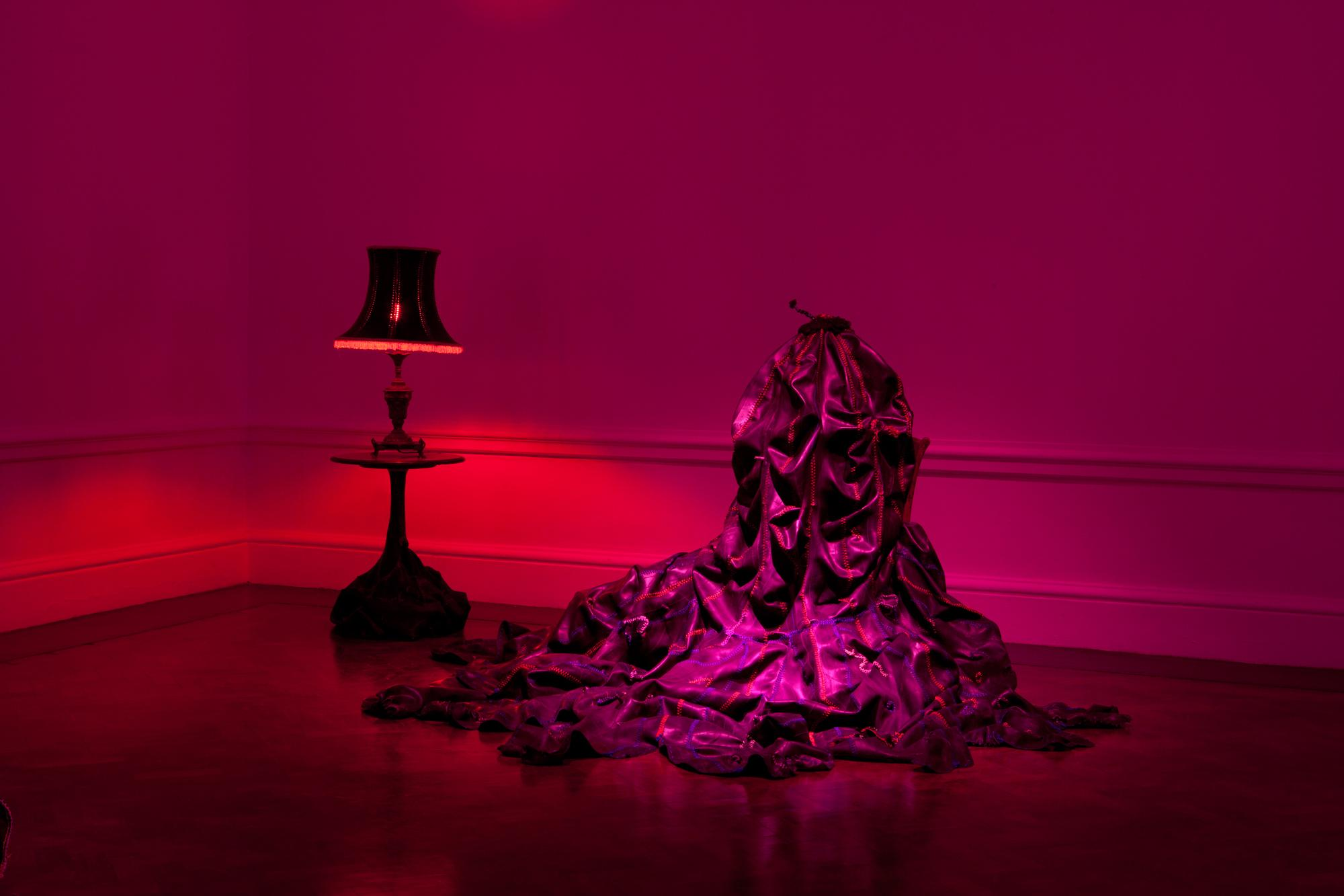"""This undated image released by Nicholas Hlobo and Stevenson shows the art piece """"Kubomvu (2009),"""" made from a found table, found lamp, rubber inner tube, ribbon and red light bulb. The work will appear as part of South African artist Nicholas Hlobo's new installation """"Intethe (Sketch for an Opera)"""" at Locust Projects in Miami during Art Basel Miami Beach, Dec. 5-8. (AP Photo/Nicholas Hlobo and Stevenson)"""