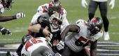New Orleans Saints quarterback Drew Brees, center, is tackled between Tampa Bay Buccaneers' Devin White (45), Lavonte David (54) and Rakeem Nunez-Roches (56). (AP Photo/Brett Duke)