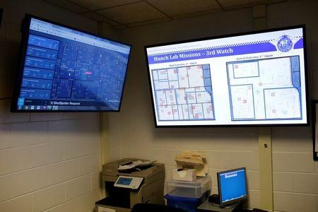The Chicago Police Department Police Observation Devices, which helps control crime, are displayed on monitors at the 7th District police station in Chicago, Illinois, U.S. January 5, 2018. REUTERS/Joshua Lott