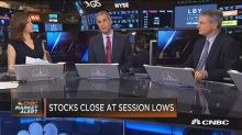 Stocks close at session lows