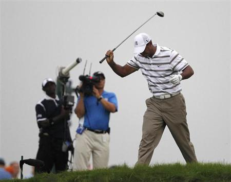 Tiger Woods reacts after his tee shot on the sixth hole during the PGA Golf Championship at Whistling Straits