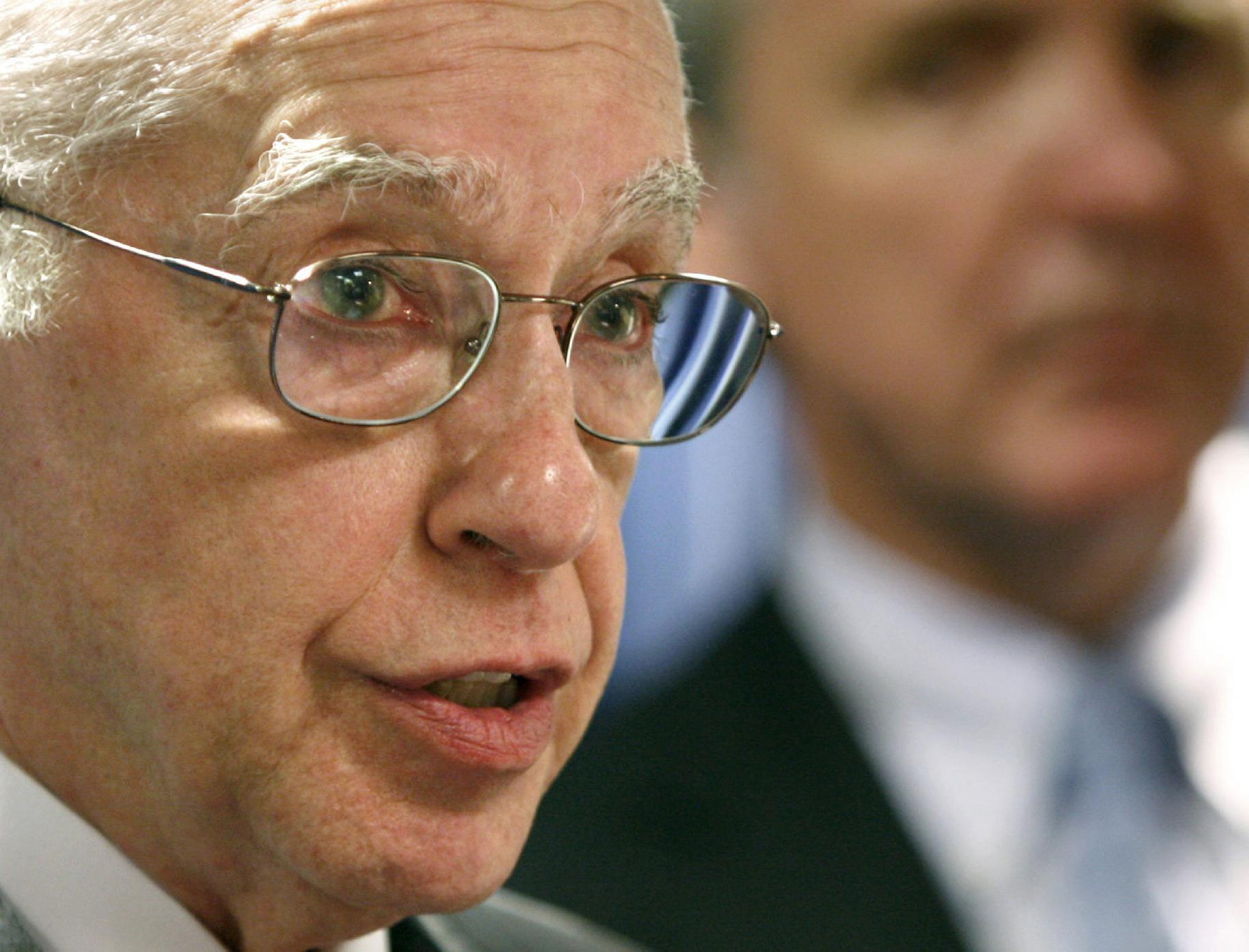 FILE - In this Aug. 5, 2008, file photo, then-Attorney General Michael Mukasey, left, speaks in Boston. At the center of a hotly disputed Senate torture report is America's biggest counterterrorism success of all: the killing of Osama bin Laden. The still-classified, 6,200-page review concludes that waterboarding and other harsh interrogation methods provided no key evidence in the hunt for bin Laden, according to congressional aides and outside experts familiar with the investigation. The CIA still disputes that conclusion. (AP Photo/Steven Senne, File)