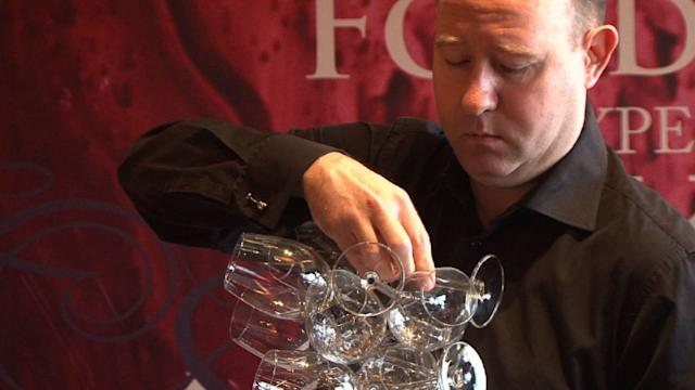 World record sees 45 glasses in one hand