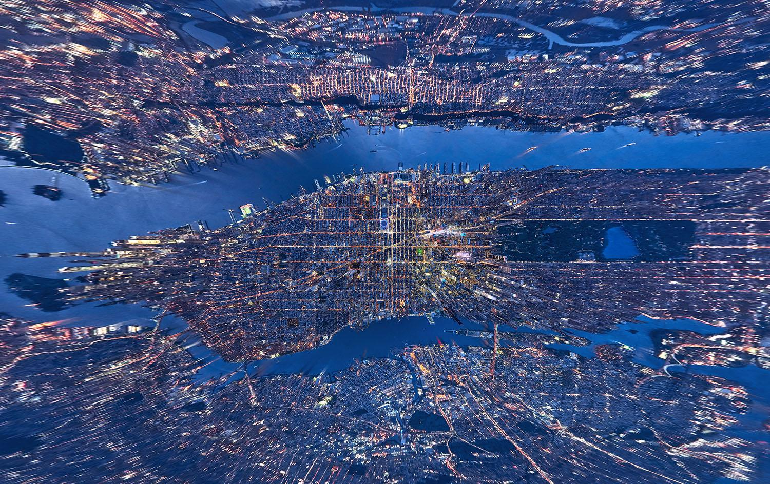 <p>These incredible, mind-bending aerial images offer a completely different way to view the vibrancy of New York City. Shot from above, some of the distorted images make the Big Apple appear like a planet, while others, photographed directly downward, make skyscrapers look like something out of an abstract artwork. (Photo: Andrew Griffiths/Lensaloft/Caters) </p>