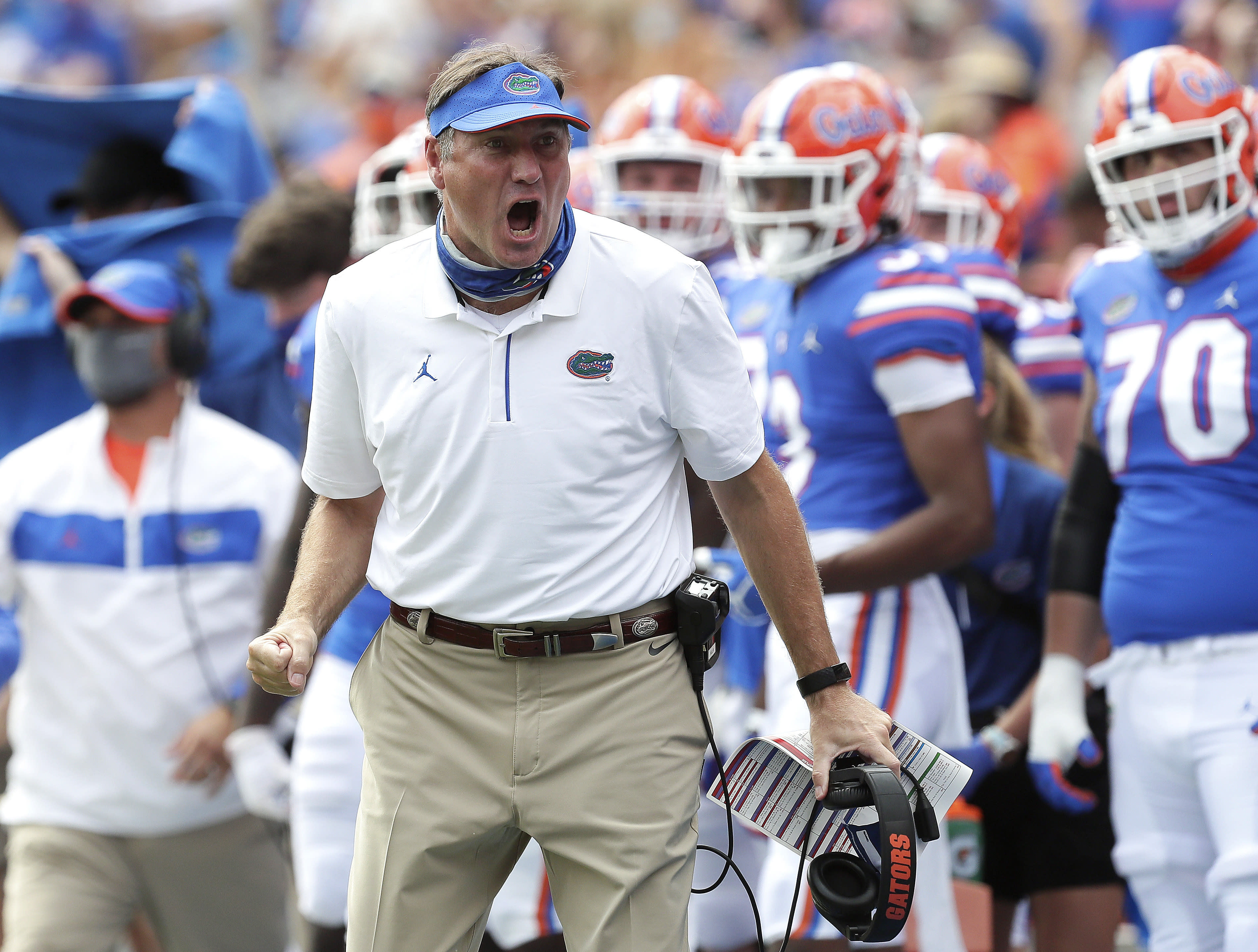 FILE - In this Oct. 3, 2020, file photo, Florida head coach Dan Mullen yells to a referee about a call during an NCAA college football game against South Carolina in Gainesville, Fla. Mullen was given several more chances Monday, Oct. 12, 2020, to walk back bizarre comments about wanting to pack 90,000 screaming fans inside Florida Field during the coronavirus pandemic. He declined each of them, brushing aside criticism and insisting he's focused on defending national champion LSU. (Brad McClenny/The Gainesville Sun via AP, Pool, File)