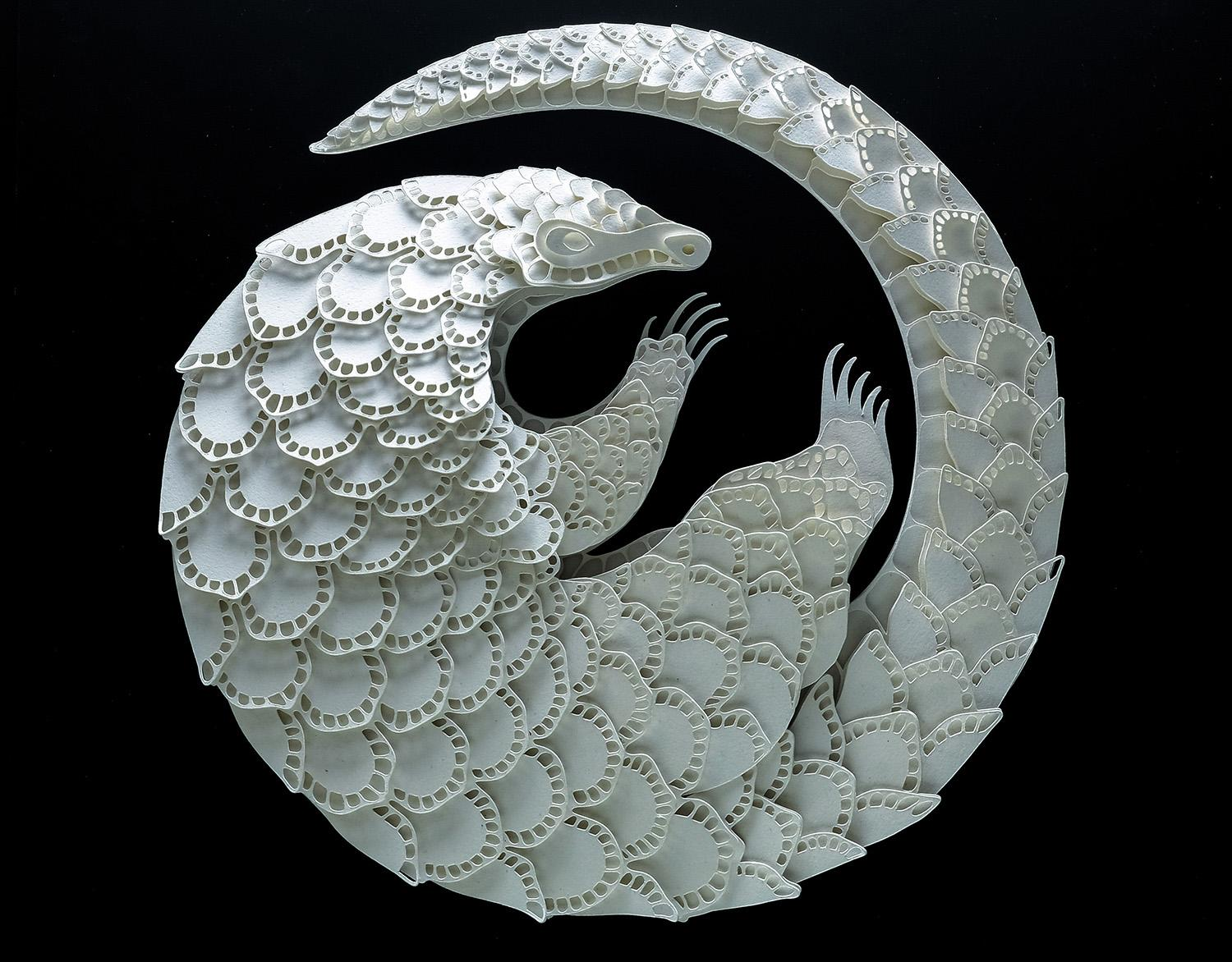 <p>Intricate paper cut out of a pangolin. (Photo: Patrick Cabral/Caters News </p>