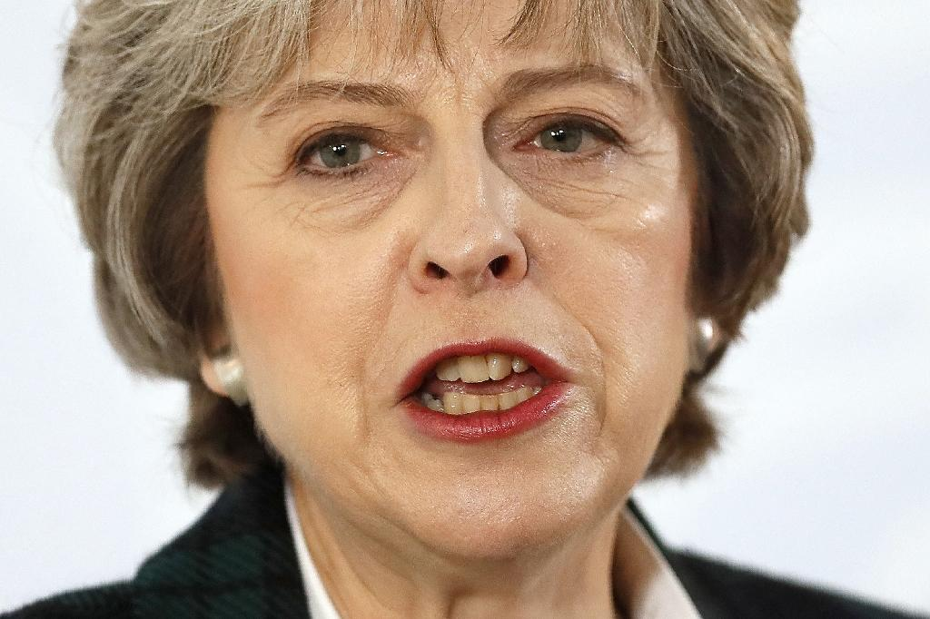 May puts Britain on course for 'hard' Brexit