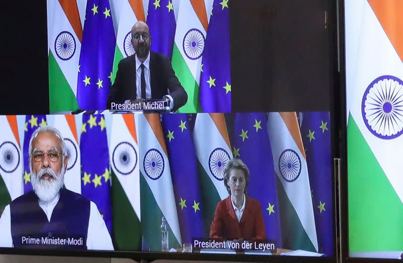 European Council President Charles Michel, Ursula von der Leyen and Indian Prime Minister Narendra Modi are seen on the monitor as they take part in a virtual summit, in Brussels