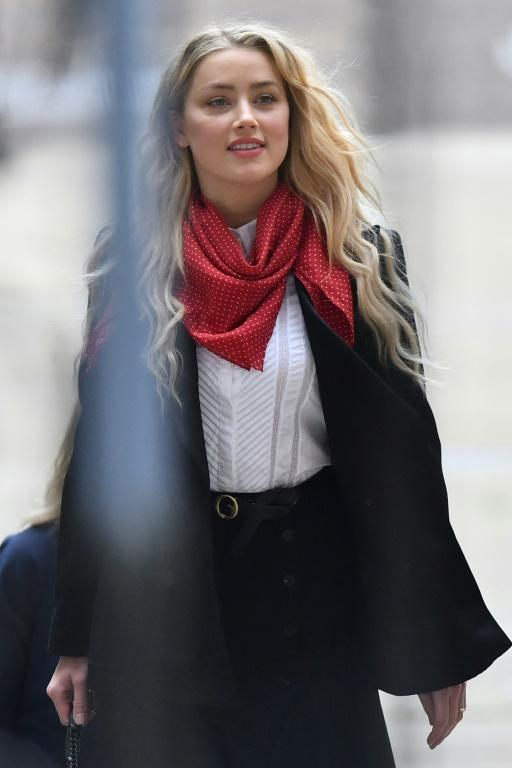 """A stylist for US actress Amber Heard told London's High Court she """"never noticed"""" bruises allegedly caused by ex-husband Johnny Depp (AFP Photo/JUSTIN TALLIS)"""
