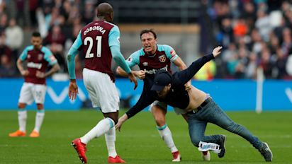 fans of struggling west ham lille charge field