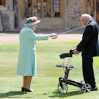 Queen knights Captain Tom, 100-year-old raising millions for healthcare workers, in rare ceremony