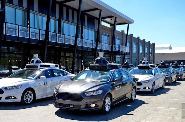 Former Google worker barred from Uber's self-driving division by court (updated)