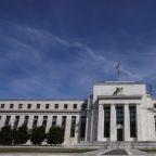 Fed pumps more cash as key rate breaks above target