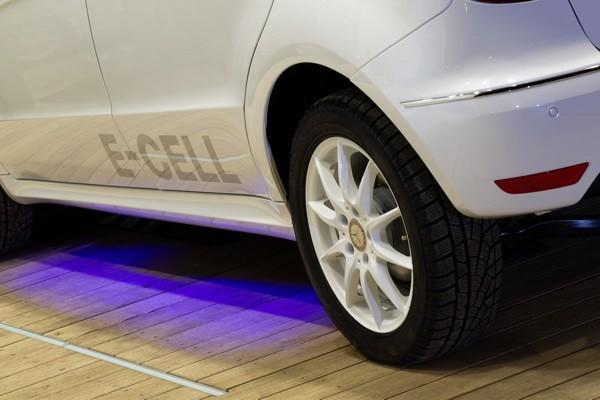 Daimler testing wireless charging on a Mercedes Benz in a house from the future